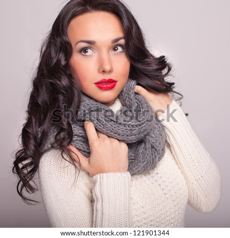 the girl close up in a warm sweater and a scarf - stock photo