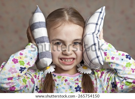 The girl closed the ears cushions - stock photo