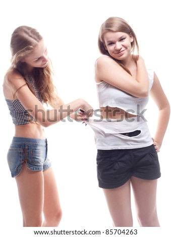 The girl cut shirt on another woman studio photography