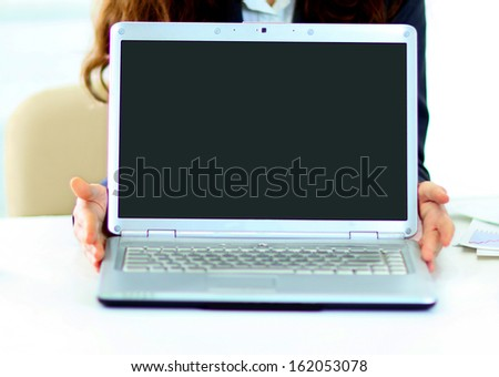 The girl demonstration of the laptop. - stock photo