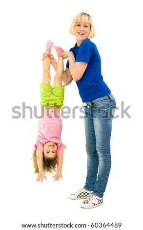 The girl does gymnastics with the child, a white background