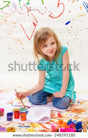 The girl draws gouache - stock photo