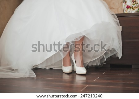 The girl dresses a wedding dress.
