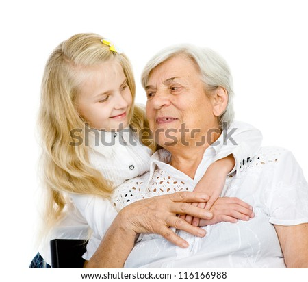 the girl embraces the old woman. isolated on white background