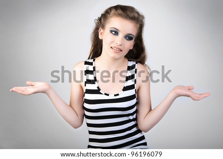 The girl gestures which no - or. Beautiful young woman studio shot portrait. - stock photo