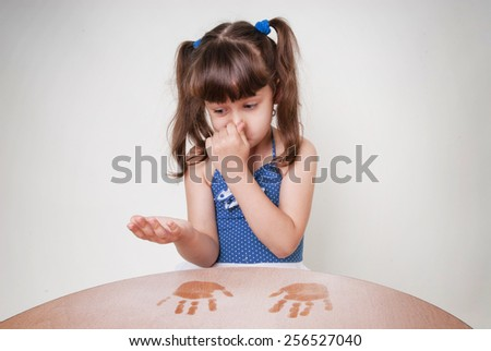 The girl hands soiled in the dust. Allergies to dust - stock photo