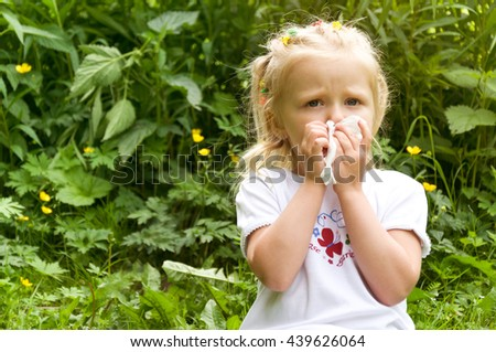 The girl has a runny nose. flowers pollen allergy