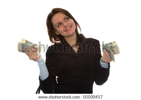 The girl holds a lot of money and smiles. Isolate on white
