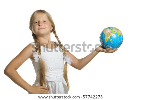 The girl holds the globe collected from puzzle in hands. It is isolated on a white background