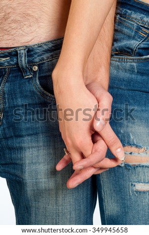 The girl holds the hand of Man. Close-up image of a young couple holding hands.  - stock photo