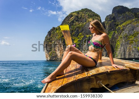 The girl in a bathing suit on a boat on Thai island of Phuket - stock photo