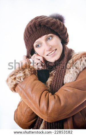 The girl in a coat speaks by phone - stock photo