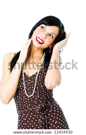 The girl in a dress in peas - stock photo