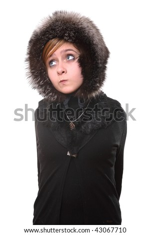 The girl in a fur cap looks aside