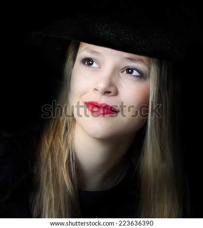 The girl in a hat. - stock photo