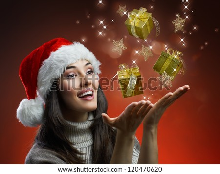 the girl in a hat with a gift - stock photo