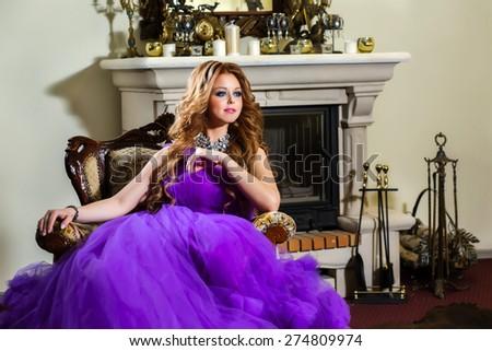 The girl in a luxury purple dress  - stock photo