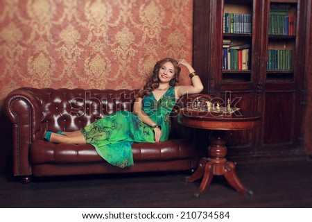 The girl in a magnificent office plays chess - stock photo
