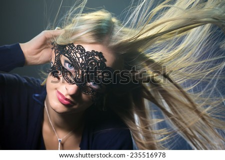 The girl in a mask - stock photo