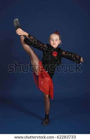 The girl in a red and black dancing suit, on a dark blue background