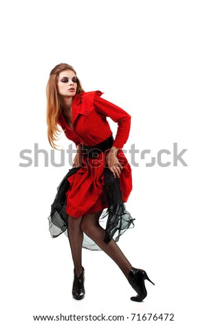 The girl in a red dress in a stockings on white background