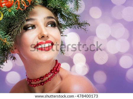 The girl in a wreath of fir branches