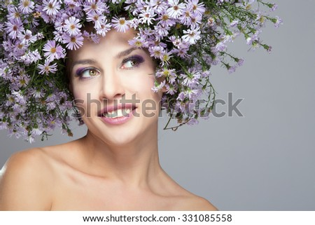 The girl in a wreath of purple daisies - stock photo
