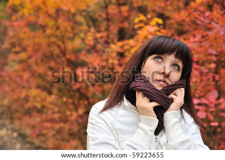 The girl in an autumn forest. The European appearance - stock photo
