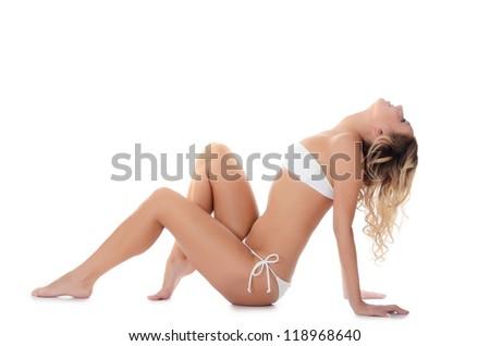 The girl in bikini isolated on white - stock photo