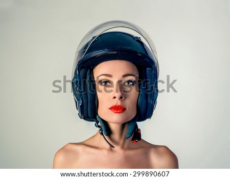 The girl in black biker helmet