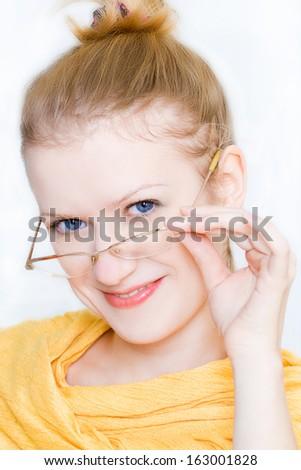 The girl in glasses. Blonde. smile - stock photo