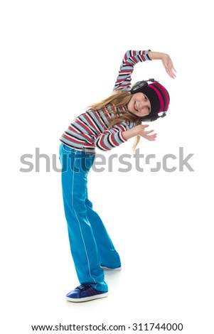 The girl in headphones dancing to the music on a white background. - stock photo