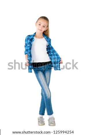 The girl in jeans and a checkered shirt is photographed on the white background - stock photo