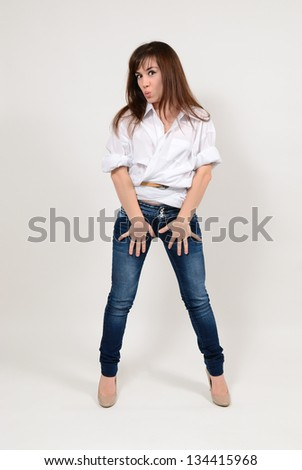 The girl in jeans and a white shirt has fun