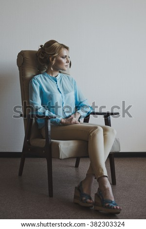 The girl in the chair.