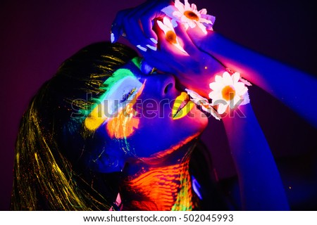 the girl in the neon light pictures neon colors on the body