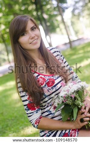 the girl in the park bear enjoying the summer - stock photo