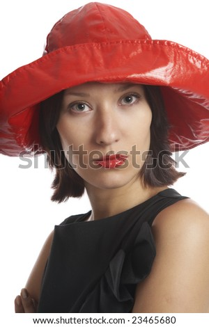 The girl in the red hat on a white background - stock photo