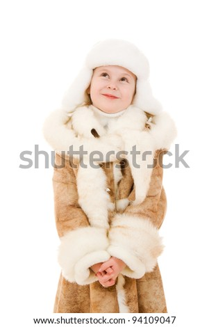 The girl in warm clothes looking up on white background.