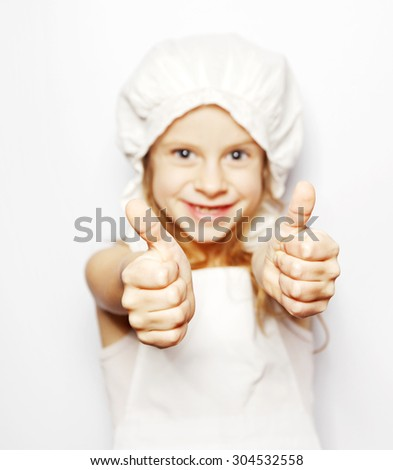 the girl in white is smiling and showing thumbs up - stock photo