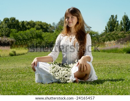 The girl in with a bunch of flowers - stock photo