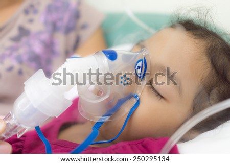 The girl is being cured the lung infection. - stock photo