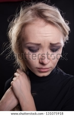 The girl is crying - stock photo