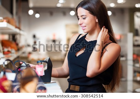 The girl is happy because she found the shoes, which she dreamed. - stock photo