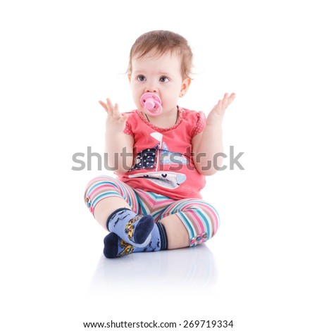 The girl is one year sitting on a white background. - stock photo