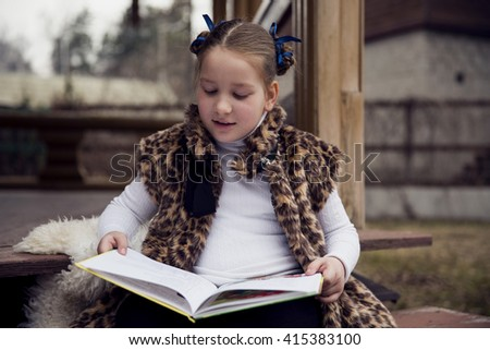 The girl is reading a book. - stock photo