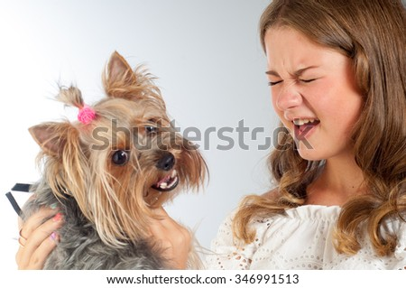 The girl is talking to another dog