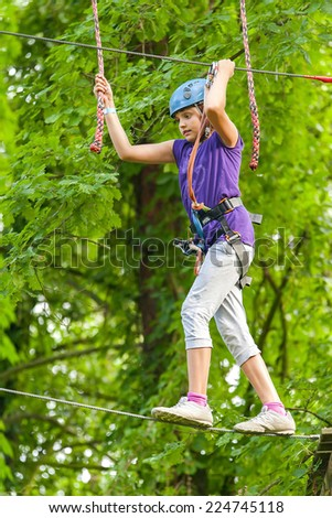 the girl is walking the tightrope - stock photo