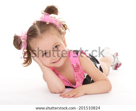 The girl lay on the floor on a white background.happy childhood,sweet child having fun outdoor,playing isolated on white background, happiness concept,adorable child having fun in studio - stock photo