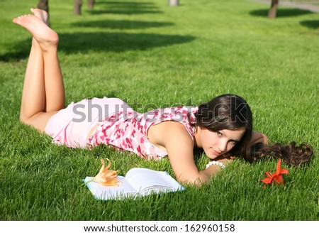 The girl laying on a grass